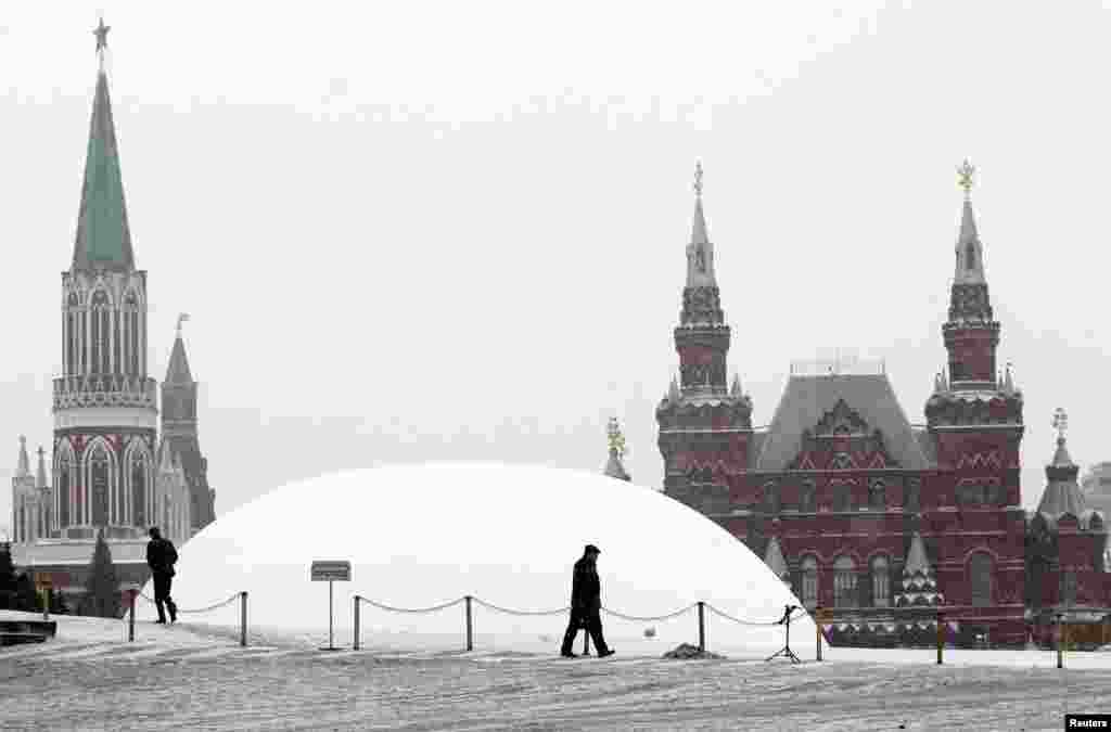 A temporary white dome covers the mausoleum of Vladimir Lenin on Red Square in Moscow. The mausoleum was closed for planned repairs and renovation work. Lenin's body will remain inside. (Reuters/Mikhail Voskresensky)
