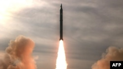 An Iranian mid-range missile test in December. The IAEA is concerned that Iran is developing a nuclear payload.