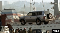 Used cars are unloaded at the port in Vladivostok