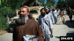 Taliban prisoners walk in line before their release from Bagram prison in the northern province of Parwan on May 26.