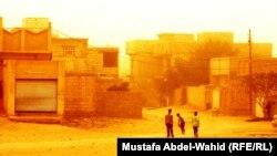 أجواء برتقالية في أحد أحياء كربلاء