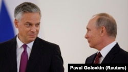 Russian President Vladimir Putin (right) and the new U.S. ambassador to Russia, Jon Huntsman, after receiving his diplomatic credentials during a ceremony at the Kremlin in Moscow on October 3.