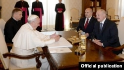 Pope Francis (left) meets with a delegation from Belarus led by President Alyaksandr Lukashena (right) in the Vatican on May 21.