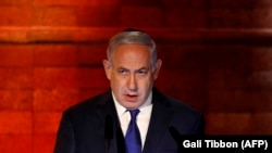 Премьер-министр Биньямин Нетаньяху Холокостту эскерүү жыйынында сүйлөп жаткан кези. Иерусалим, 11-апрель, 2018-жыл.