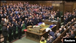 Депутаты палаты общин парламента Великобритании.