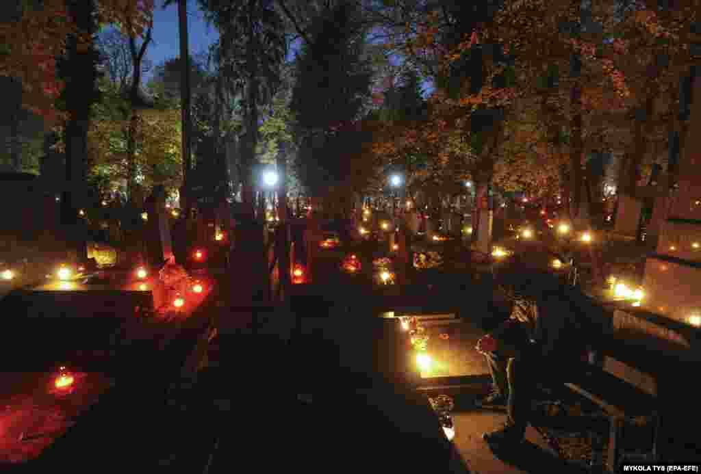 Ukrainians attend Lychakiv cemetery's Memory Candles ceremony in Lviv.