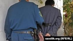 Uzbekistan - handcuffs, Uzbek police is detaining accused man, where?, 27Feb2012