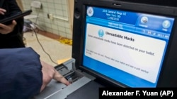 A New York City Board of Elections ballot scanning machine is shown at a polling station in Brooklyn.