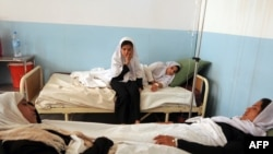 Hospitalized schoolgirls with symptoms of poisoning in Charikar, the second of three recent similar incidents.