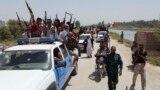 ابناء عشائر يرافقون قوات امن عراقية في ديالى