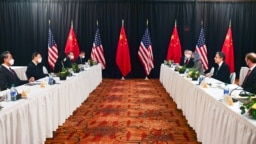 U.S. Secretary of State Antony Blinken (second right) and national-security advisor Jake Sullivan (right) speak while facing Yang Jiechi (second left), a Politburo member and Chinese leader Xi Jinping's most senior envoy, and Foreign Minister Wang Yi (left) at the opening session of U.S.-China talks in Alaska on March 18.