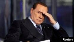 Италия собиқ бош вазири Силвио Берлускони.
