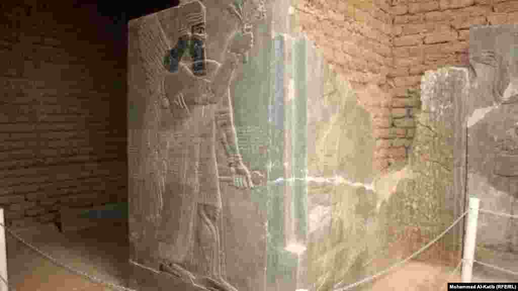A stela -- a carved or inscribed stone slab or pillar used for commemorative purposes -- in the ancient Assyrian city of Nimrud featuring a relief of an Assyrian king or deity. This and the following photos were taken by RFE/RL's Radio Free Iraq in 2012.
