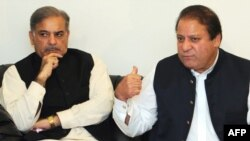 Nawaz Sharif (right), leader of the Muslim League Nawaz Group, and his brother Shahbaz Sharif in Lahore on February 25