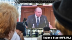 Prime Minister Valeriu Strelet is seen on a screen outside the parliament building in Chisinau as he speaks inside shortly before he was dismissed on October 29.