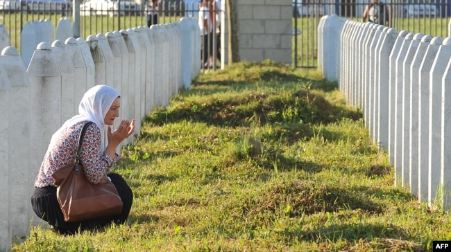A Bosnian Muslim woman and survivor of the Srebrenica massacre, mourns near graves of her relatives at a memorial cemetery in eastern Bosnia. (file photo)