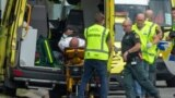 An injured person is loaded into an ambulance following a shooting in Christchurch, New Zealand