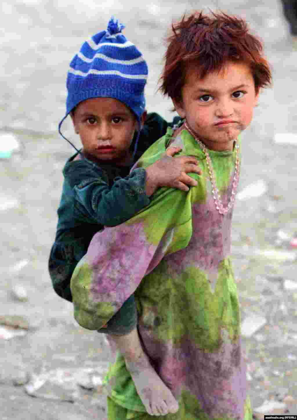Children at a UN camp. Photo by RFE/RL's Radio Free Afghanistan - Many children in Afghanistan are orphans, as half of the country's population is reported to have lost family members in years of fighting.