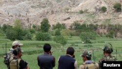 Afghan Special Forces monitor the site where a massive U.S. bomb was used against militants in the eastern province of Nangarhar.