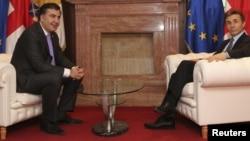 Президент Грузии Михаил Саакашвили (слева) и премьер-министр Грузии Бидзина Иванишвили. Тбилиси, 4 марта 2013 года.