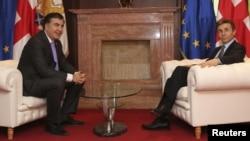 Премьер-министр Грузии Бидзина Иванишвили (справа) и президент Михаил Саакашвили. Тбилиси, 4 марта 2013 года.