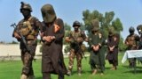 Afghan security personnel escort arrested alleged Taliban and Islamic State militants during an operation in Jalalabad, the capital of eastern Nangarhar province on October 1.