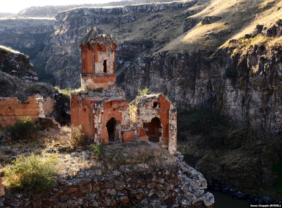 "In a gorge that separates Armenia (background) from Turkey, the Monastery of the Hripsimian Virgins is one of the crumbling remnants of Ani, a capital once known as the ""City Of 1,001 Churches."""