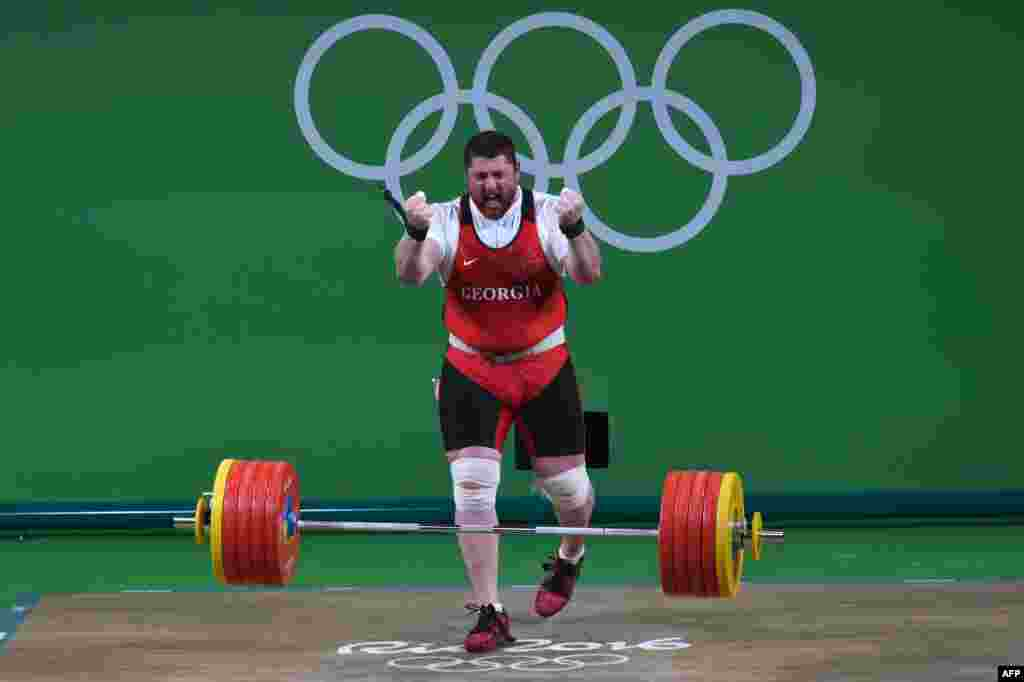 Georgia's Lasha Talakhadze celebrates after winning gold in the men's 105-kilogram+ weightlifting.