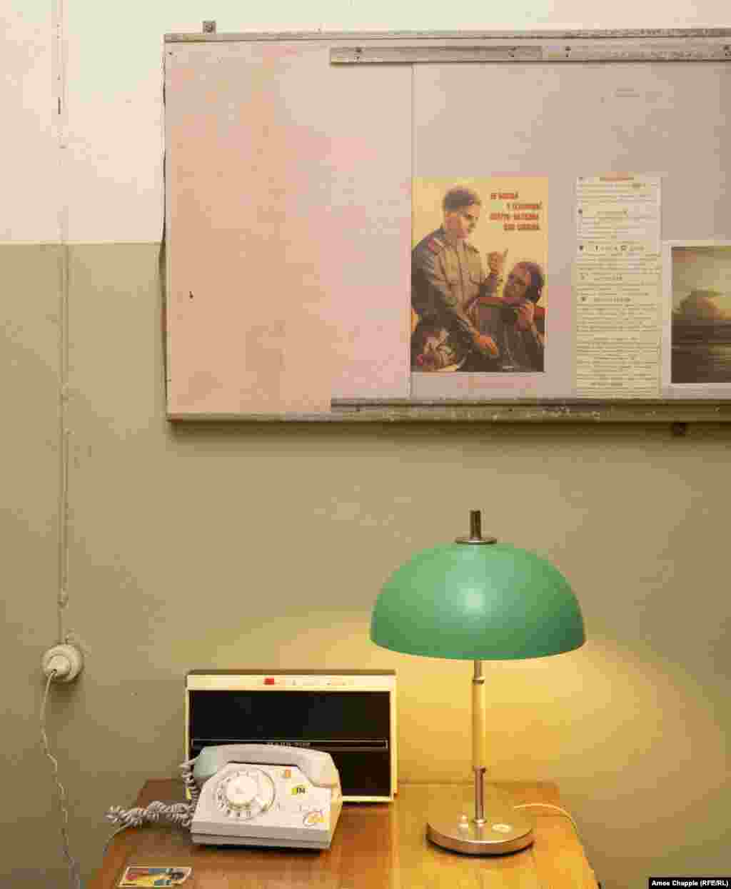 An office in the bunker with a poster reminding comrades not to chat on the telephone in case spies are listening. Kinder believes the ban on photography in some rooms is more about maintaining the mystique than hiding sensitive information.