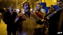 Եգիպտոս - Բախումների հետևանքով մահացած երիտասարդի հայրը Կահիրեի դիահերձարանի մոտ, 8-ը փետրվարի, 2015թ․