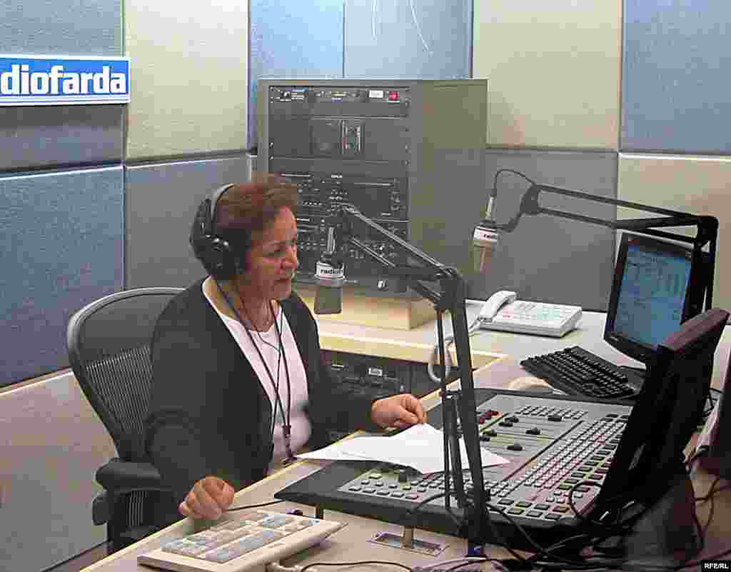 Broadcaster Maryam Ahmadi reads the first news broadcast of the new Radio Farda, RFE's service to Iran, December 2002.