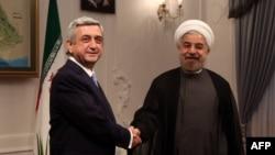 Iran -- Armenian President Serzh Sarkisian (L) meets with Iran's new President Hasan Rohani (R) at his office in Tehran on August 5, 2013.