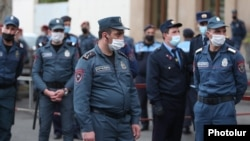 Armenia -- Riot police guard a court building in Yerevan during the trial of former President Robert Kocharian and three other former officials, May 13, 2020.