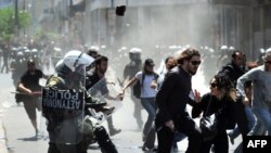 Riot police pursued protesters, during a May Day demonstration in Athens on May 1.