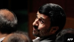 Iranian President Mahmud Ahmadinejad looks back before addressing the Nuclear Nonproliferation Treaty (NPT) Review Conference in New York today.