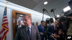 Sen. Lindsey Graham, R-S.C., chairman of the Senate Judiciary Committee, finishes his response to reporters about his earlier advice to Donald Trump Jr. on being subpoenaed by the Senate Intelligence Committee, on Capitol Hill in Washington, Tuesday, May