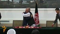 Afghan Rival Candidates Sign Power-Sharing Deal