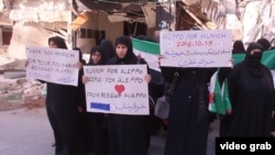 """Syria -- Members of the """"Free Women of Aleppo"""" protest against Russian air strikes. Aleppo. October 15, 2016."""