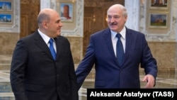 Belarusian President Alyaksandr Lukashenka (right) meets with Russian Prime Minister Mikhail Mishustin in Minsk on September 3.