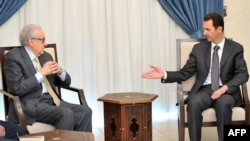 Syrian President Bashar al-Assad (right) meets with UN-Arab League peace envoy Lakhdar Brahimi in Damascus on October 30.