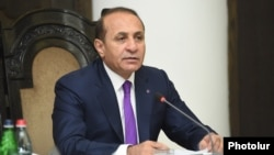 Hovik Abrahamian announces his resignation as prime minister at a cabinet meeting in Yerevan on September 8.