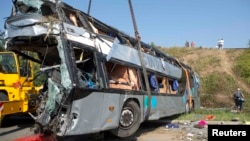 A wrecked bus at the site of the fatal accident near Dresden, Germany, on July 19.