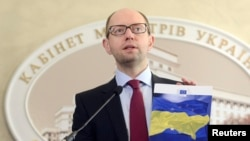 "Ukrainian Prime Minister Arseniy Yatsenyuk said that Ukraine was ready for talks with Russia, but that Moscow must withdraw its troops from Crimea and stop its support for ""separatists and terrorists."""