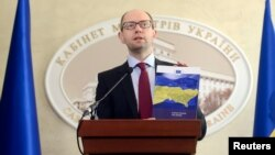 Ukrainian Prime Minister Arseniy Yatsenyuk at a news conference at the cabinet of ministers building in Kyiv on March 7.