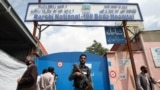 An Afghan policeman keeps watch outside of a hospital that came under attack in Kabul on May 13.