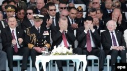 Turkey -- Britain's Prince Charles (2-L), Turkish President Recep Tayyip Erdogan (C) and other guests observe a prayer during a commemoration event of the Battle of Gallipoli in front of the Turkish Mehmetcik Monument, in Gallipoli, 24 April 2015.