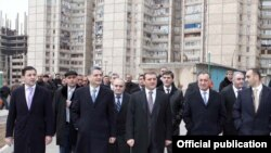 Armenia - Prime Minister Tigran Sarkisian (second from left) visits a Yerevan suburb, 22Nov2011.