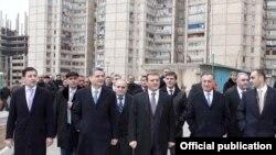 Armenia - Prime Minister Tigran Sarkisian (second from left) visits a Yerevan suburb, 22Nov2011.