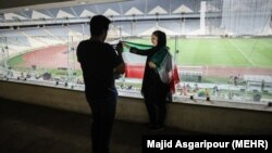 Iranian football fans in Iran watching Iran Spain game via screen