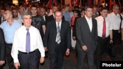 Armenia - Hanrapetutyun party leader Aram Sarkisian (L) and former President Levon Ter-Petrosian (C) lead an opposition demonstration in Yerevan.